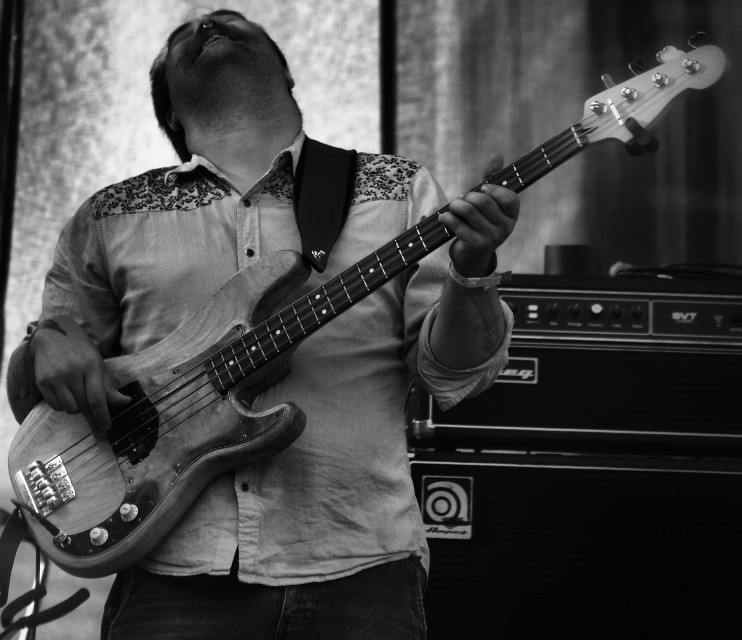 The Irish singer Mundy  (not pictured) hired local musicians to fill in at his set at the Kansas City Irish Festival 2015.   Way Back When  #bass #guitar #people  #concert #kc #kcirishfest15 #kansascity   #music #blackandwhite #instrument #emotions #fun #photography  #artistic